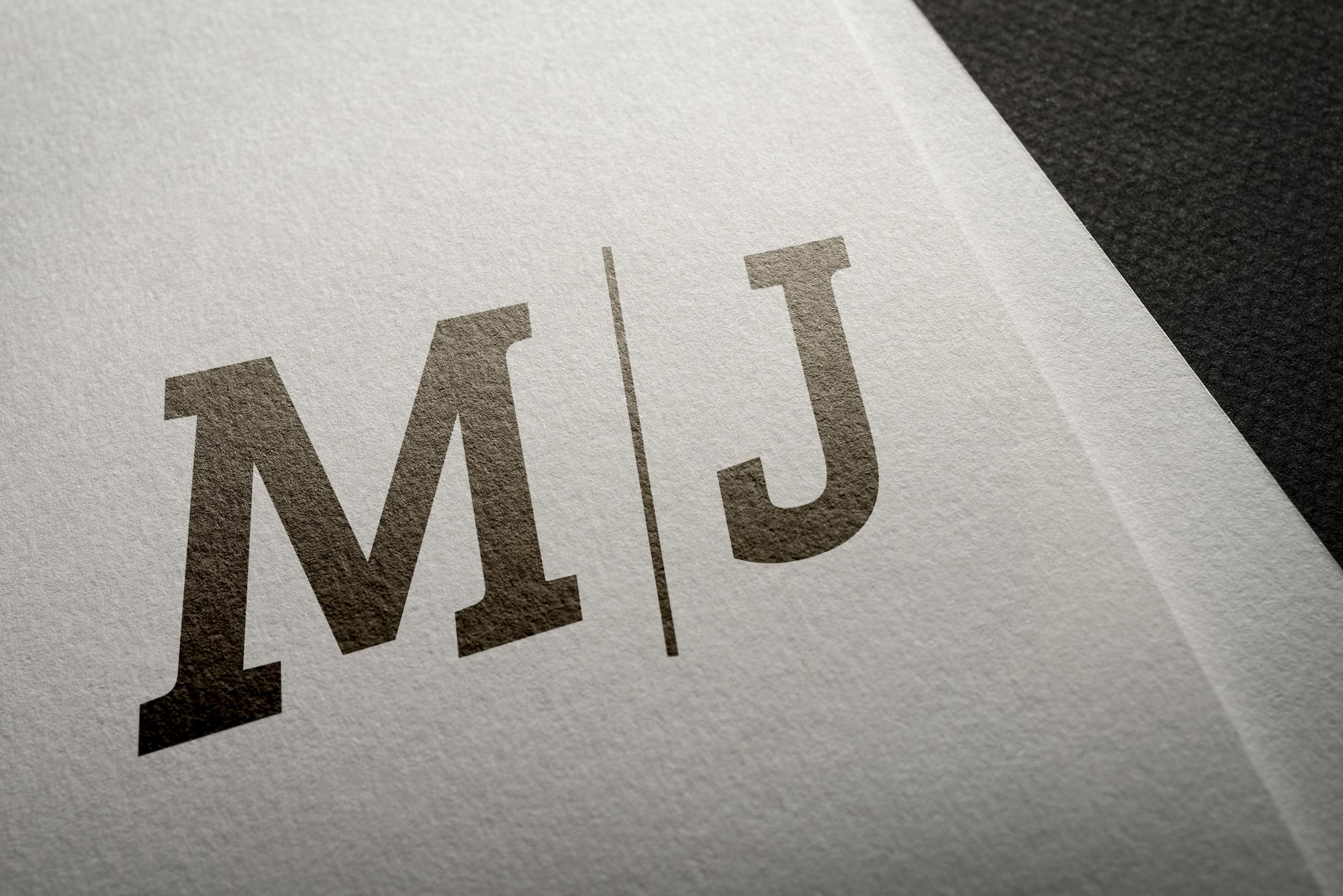 M/J black logo on white paper