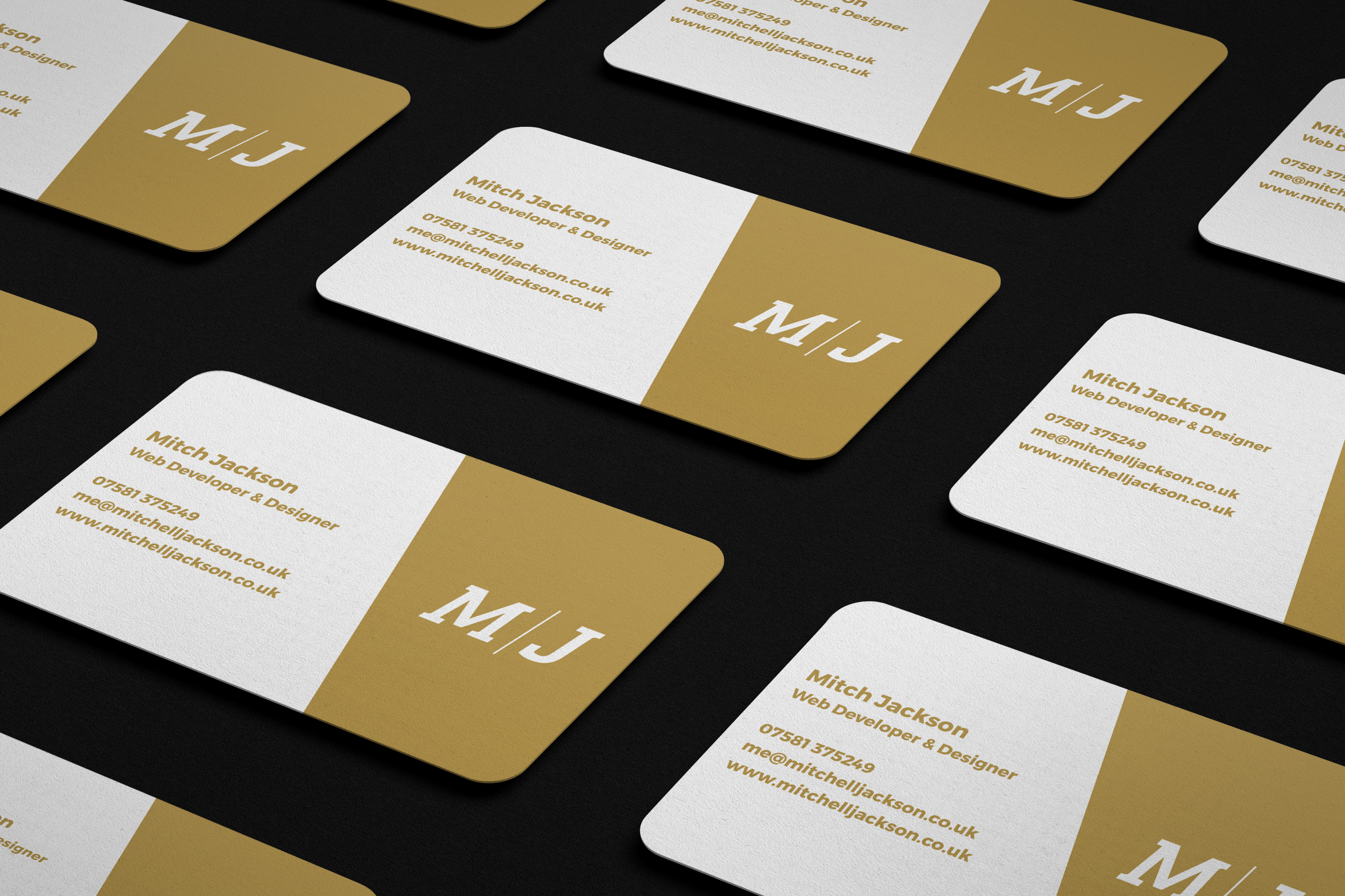 M/J business cards in rows on desk