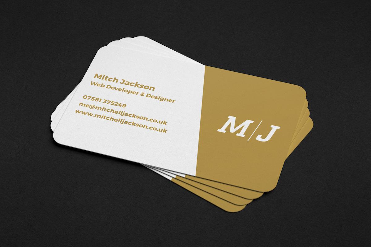 Stack of M/J business cards on desk